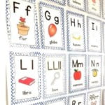 We use wall cards and a daily calendar tracking page to practice learning Spanish basics vocabulary/.
