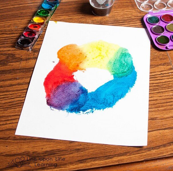 "We created ""all the colors in the world"" like the color kittens, starting with red, yellow, and blue. Strawberry loved seeing the new colors come together as we blended the paints."