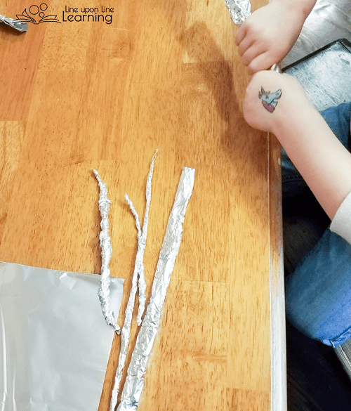 "We twisted ""snakes"" of aluminum foil to make sparkly princess jewelry."