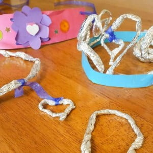 Twist aluminum foil in skinny strips to make princess jewelry.